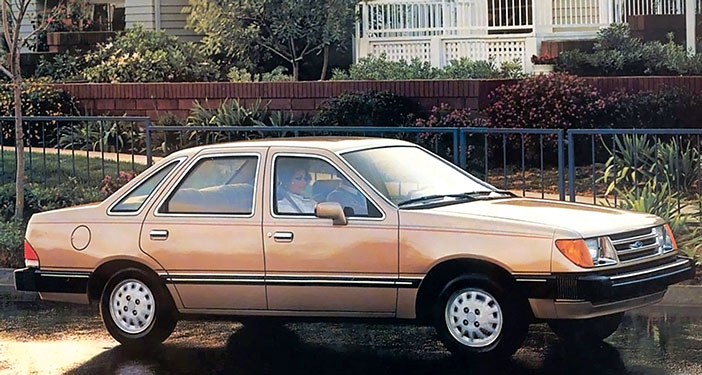1983 Ford Tempo saloon biege adv side